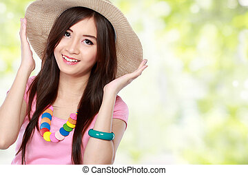 young asian woman wearing summer hat