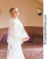 Portrait of young attractive beautiful bride. Wedding dress.