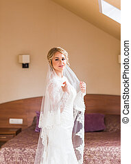 Portrait of young attractive beautiful bride. Wedding dress.