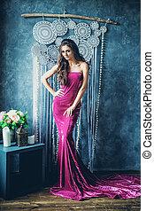 Portrait of Young Attractive Brunette Model in Luxurious Velvet Dress