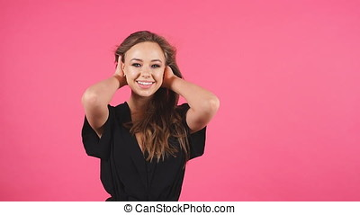 Portrait of young attractive girl smiling looking at camera. Slow motion.