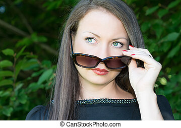 Portrait of young attractive girl with sunglasses