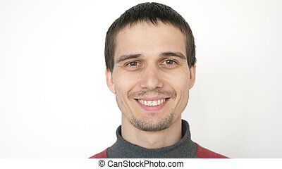 Portrait of young attractive happy man on a white background