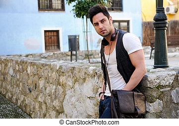 Portrait of young attractive man in urban background