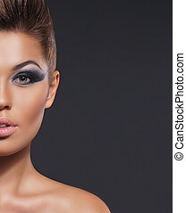 Portrait of young attractive woman in makeup concept
