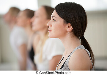 Portrait of young attractive woman practicing yoga