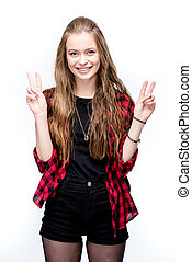 portrait of young attractive woman with peace signs looking at camera isolated on white
