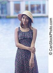 portrait of young beautiful asian tan skin woman smiling...