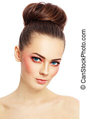 Portrait of young beautiful blue-eyed woman with stylish coral make-up over white background