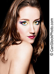 Portrait of young beautiful brown hair girl with extravagant makeup. Retouched