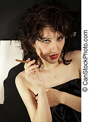 Young beautiful brunette woman with cigarette