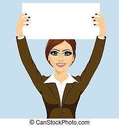 businesswoman holding white blank board