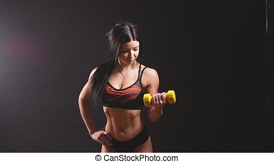 Portrait of young beautiful fitness woman ,isolated on black...