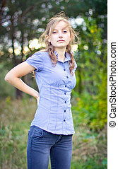 Portrait of young beautiful girl at park