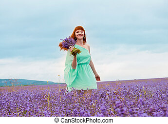 portrait of young beautiful girl in a field