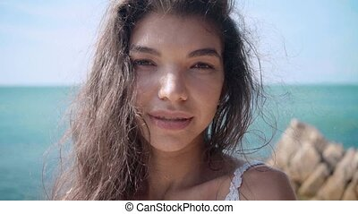 portrait of young beautiful girl near the pool, view on...