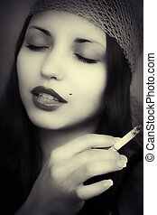 young beautiful girl with cigarette