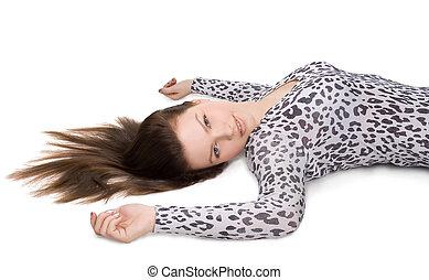 Portrait of young beautiful girl with long hair lying on the floor