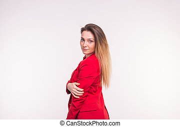 Portrait of young beautiful lady in red jacket on white background.