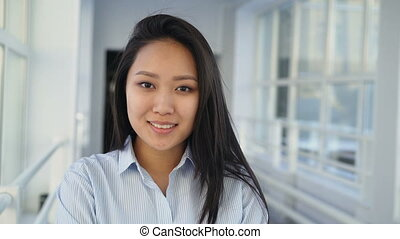 Portrait of young beautiful pretty female student of asian...