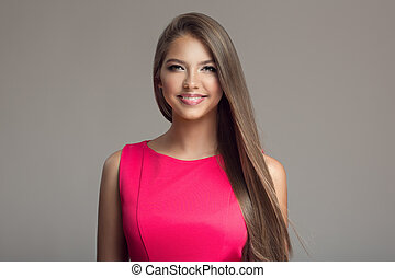 Portrait of young beautiful smiling happy woman. Long hair.