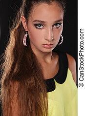 Portrait of young beautiful teen girl. Fashion photo