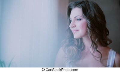 Portrait of young beautiful woman drinking coffee in...