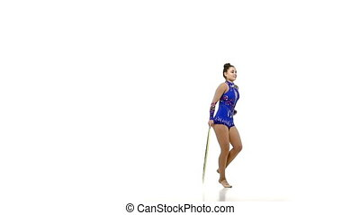 Portrait of young beautiful  woman gymnast  with hula hoop, slow motion