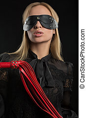 Portrait of young beautiful woman in blindfold - Portrait of...