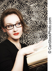 young beautiful woman in glasses with  book