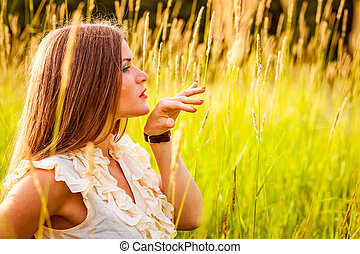 Portrait of young beautiful woman in park