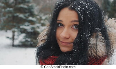 Portrait of Young beautiful woman in winter park