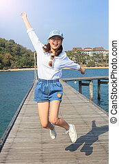 portrait of young beautiful woman jumping with happy emotion on