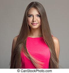 Portrait of young beautiful woman. Long hair.