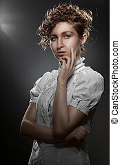 Portrait of young beautiful woman on black