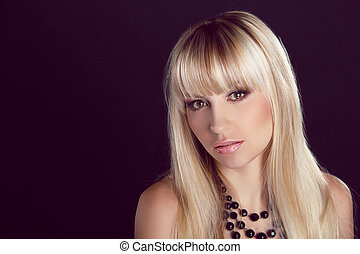 Portrait of young beautiful woman with blond glossy hair. Beauty. Long Healthy Hairstyling