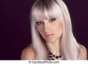 Portrait of young beautiful woman with colored glossy hair