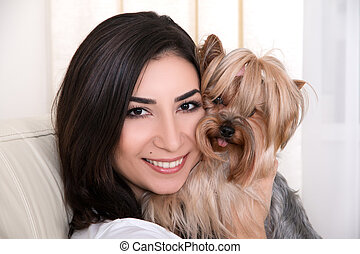 Portrait of young beautiful woman with her dog