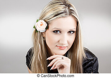 Portrait of young beautiful woman with long blond hair