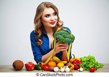Portrait of young beautiful woman with vegetables and fruits