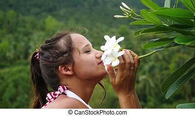 Portrait of young beauty woman touching and sniffing the...