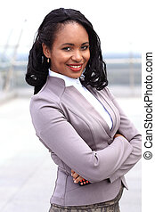 Portrait of young black businesswoman with arms