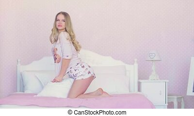 Portrait of young blonde model posing in the room