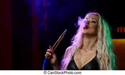 portrait of young blonde woman in the hookah room. Slow motion.
