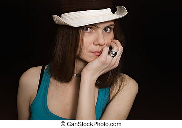 portrait of young blue-eyed girl in white hat