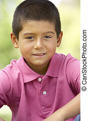 Portrait Of Young Boy In Park