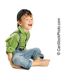Portrait of small boy in baseball cap isolated on pure white background