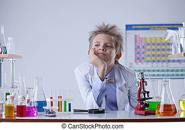 Portrait of young boy posing in laboratory