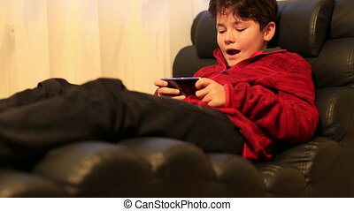 Portrait of young boy watching tv at home