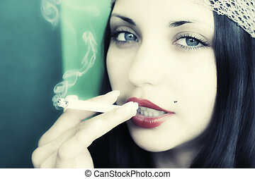 young brunet girl with cigarette
